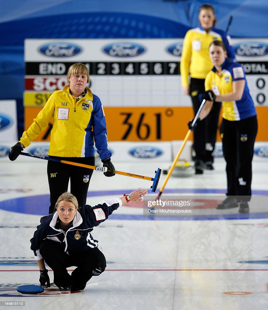 Anna Sloan of Scotland screams instructions as Maria Prytz (top L) of Sweden looks on during the Gold medal match between Sweden and Scotland on Day 9 of the Titlis Glacier Mountain World Women's Curling Championship at the Volvo Sports Centre on March 24, 2013 in Riga, Latvia.
