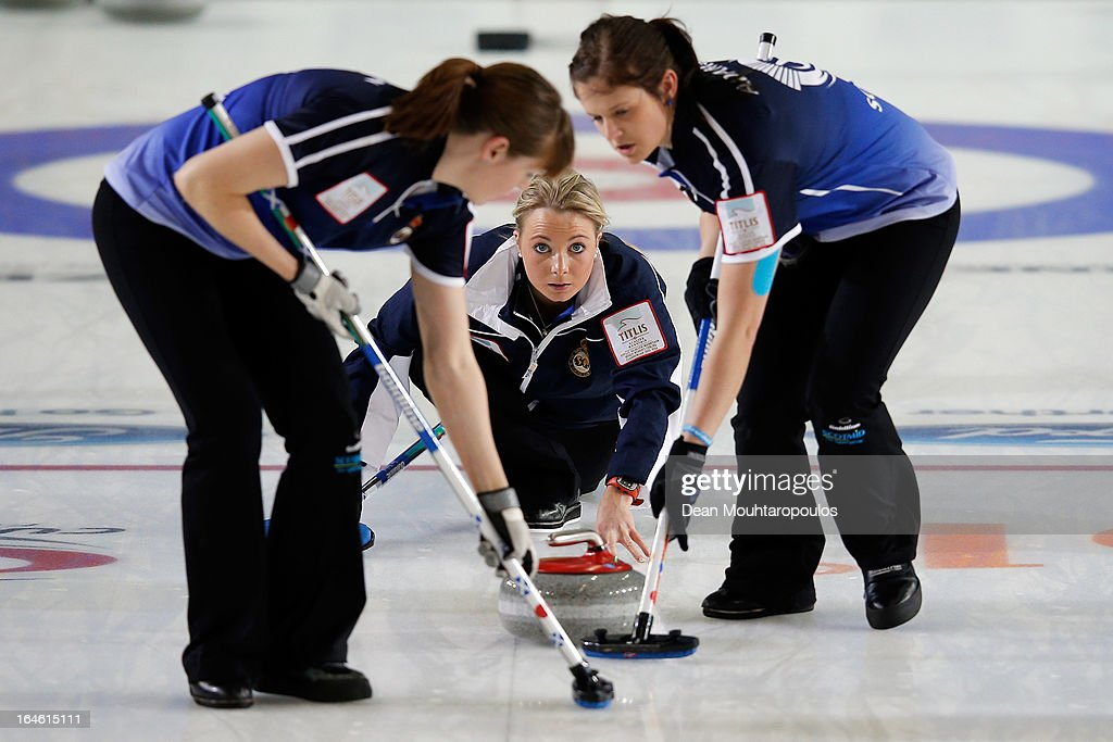 Anna Sloan (C) of Scotland throws the stone as team mates as Vicki Adams (R) and Claire Hamilton (L) sweep during the Gold medal match between Sweden and Scotland on Day 9 of the Titlis Glacier Mountain World Women's Curling Championship at the Volvo Sports Centre on March 24, 2013 in Riga, Latvia.