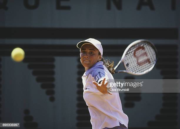 Anna Smashnova of Israel eyes the ball as she returns against Conchita Martinez during their Women's Singles third round match at the French Open...