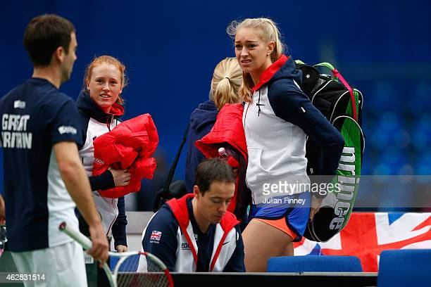 Anna Smith and Jocelyn Rae of Great Britain talk with Head of Womens Tennis Iain Bates after a practice session during day three of the Fed...