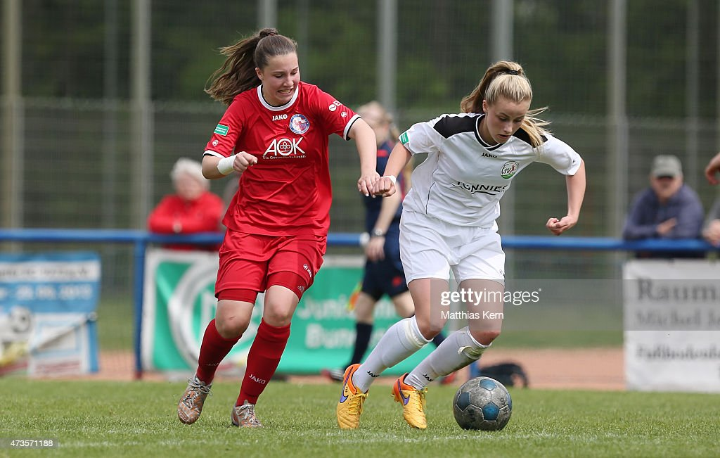Anna Sophie Frehse of Potsdam battles for the ball with Valentina Vogt of Guetersloh during the U17 Girl's Bundesliga semi final first leg match...
