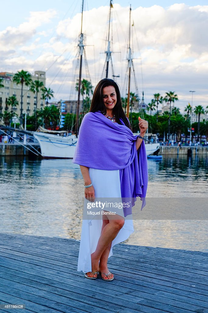Anna Stylianides from Canada seen wearing a Mauve Calymerg from Scotland, an Escada's dress and a vintage jewellery on June 25, 2014 in Barcelona, Spain.