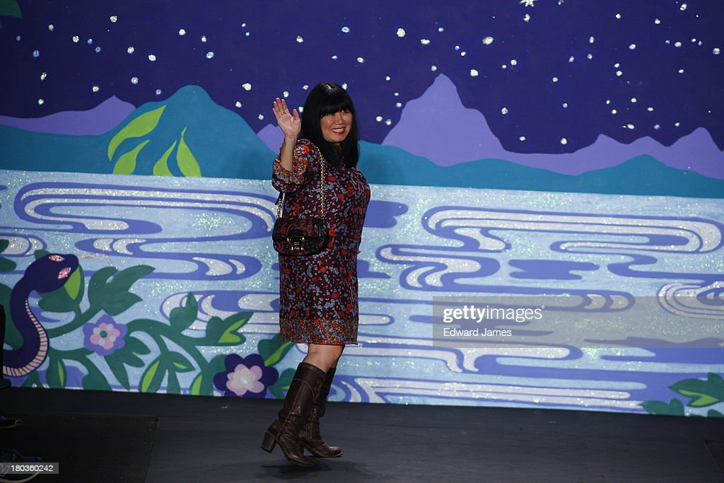 <a gi-track='captionPersonalityLinkClicked' href=/galleries/search?phrase=Anna+Sui+-+Fashion+Designer&family=editorial&specificpeople=4205399 ng-click='$event.stopPropagation()'>Anna Sui</a> walks the runway at the <a gi-track='captionPersonalityLinkClicked' href=/galleries/search?phrase=Anna+Sui+-+Fashion+Designer&family=editorial&specificpeople=4205399 ng-click='$event.stopPropagation()'>Anna Sui</a> show during Spring 2014 Mercedes-Benz Fashion Week at The Theatre at Lincoln Center on September 11, 2013 in New York City.