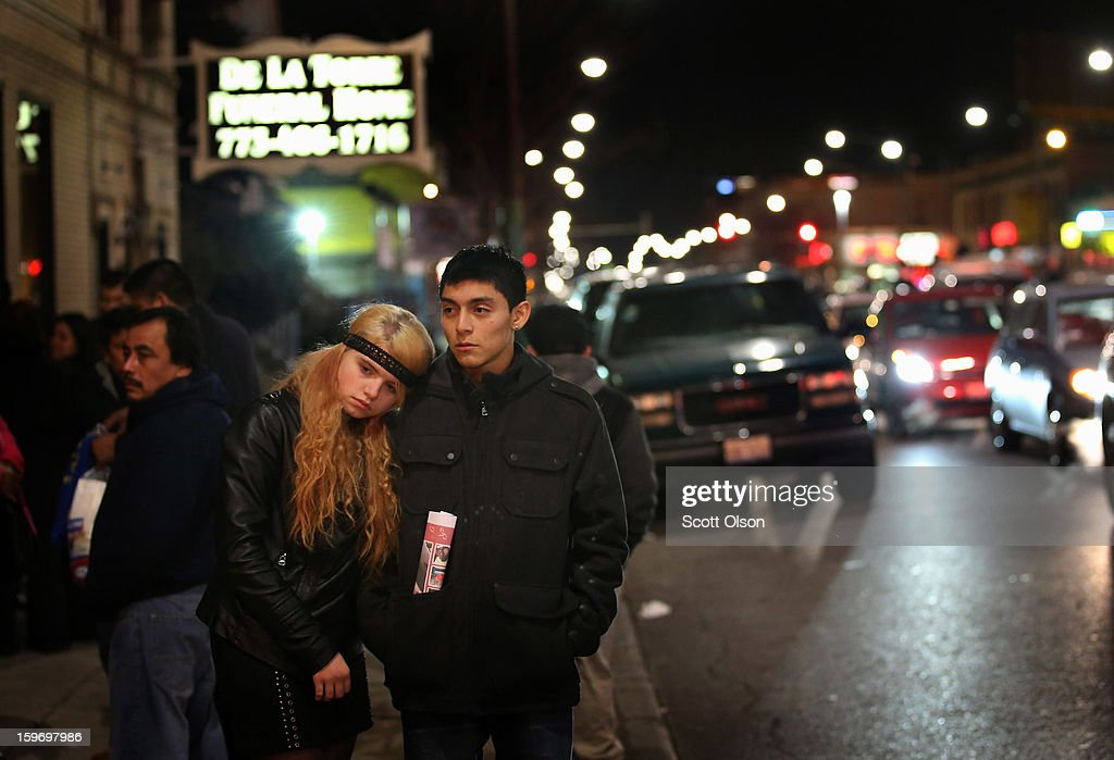 Anna Szydlo (L) and Josue Hernandez leave a wake for their close friend Rey Dorantes on January 17, 2013 in Chicago, Illinois. Dorantes, 14, died after being shot six times while he was sitting on the front porch of his home while talking on the phone on January 11. Dorantes's murder was the 21st homicide recorded in Chicago for 2013, a city which saw more than 500 homicides in 2012.