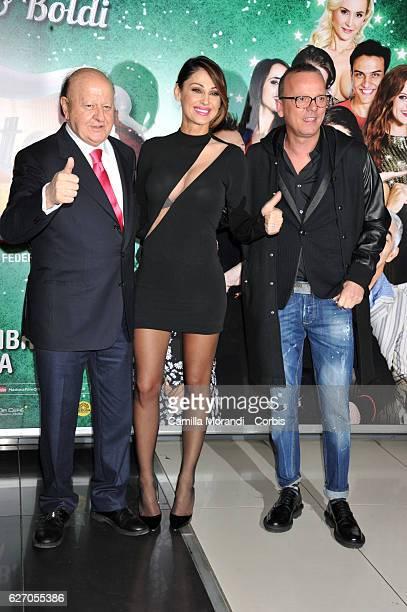 Anna Tatangelo Massimo Boldi and Gigi D'Alessio attend 'Un Natale Al Sud' Red Carpet In Rome on December 1 2016 in Rome Italy