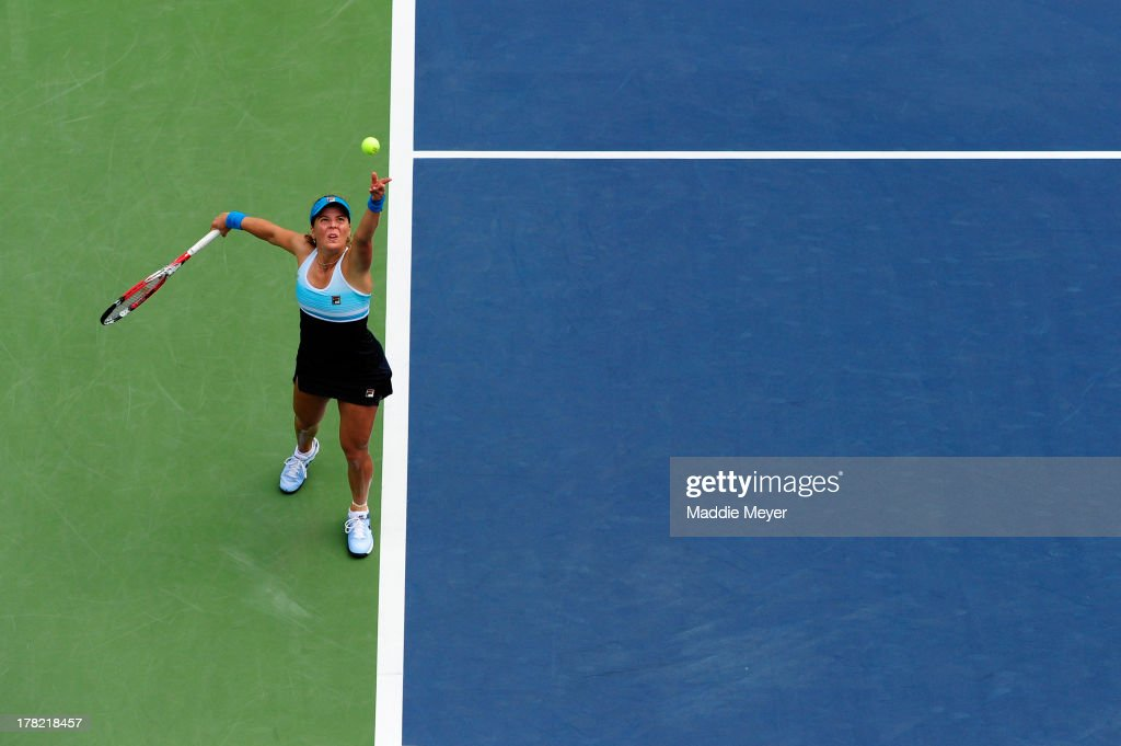 Anna Tatishvili of Georgia serves during her victory in the women's singles first round match against Ana Ivanovic of Serbia on Day One of the 2013 US Open at USTA Billie Jean King National Tennis Center on August 26, 2013 in the Flushing neighborhood of the Queens borough of New York City.