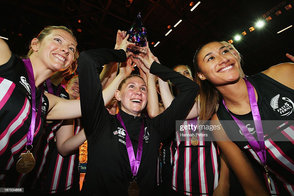 Anna Thompson, Casey Kopua and Maria Tutaia of New Zealand celebrate with the team after winning the final match between New Zealand and Australia on day three of the Fast5 Netball World Series at Vector Arena on November 10, 2013 in Auckland, New Zealand.
