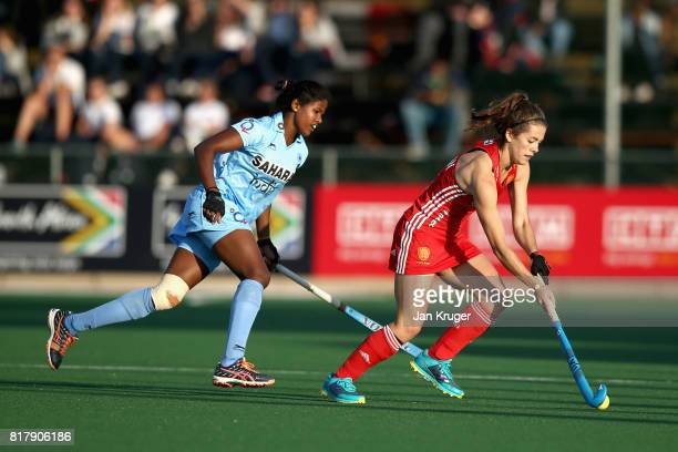 Anna Toman of England takes the ball away from Namita Toppo of India during the Quarter Final match between England and India during the FIH Hockey...