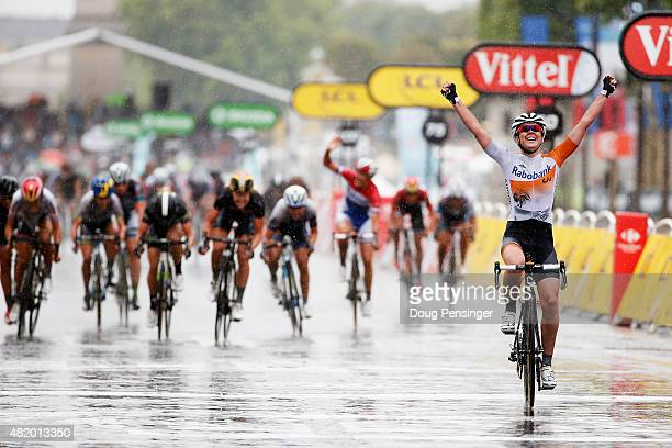 Anna Van Der Breggen of the Netherlands and Rabo Liv Woman Cycling Team celebrates as she crosses the finish line to win the La Course By Le Tour De...