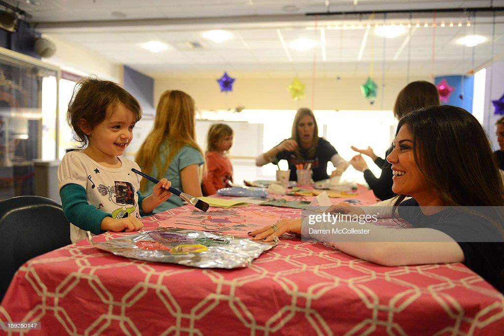 Anna Welker of the New England Patriots Women's Association visits Ava at Boston Children's Hospital on January 10, 2013 in Boston, Massachusetts.