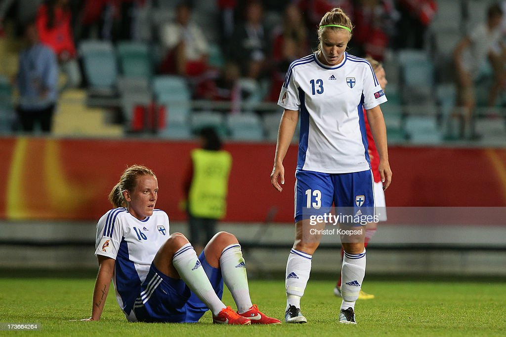 Anna Westerlund and Heidi Kivelae of Finland look dejected after the UEFA Women's EURO 2013 Group A match between Denmark and Finland at Gamla Ullevi Stadium on July 16, 2013 in Gothenburg, Sweden. The match between Denmark and Finland ended 1-1.