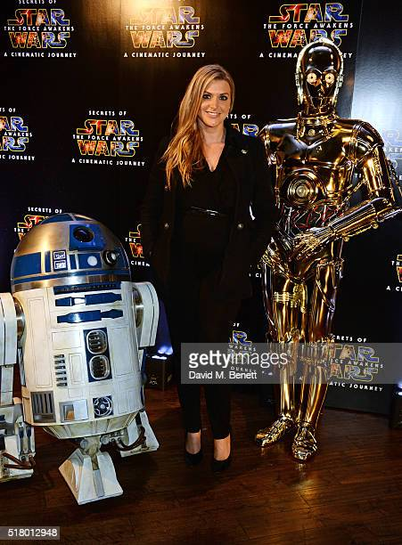 Anna Williamson poses with R2D2 and C3PO at the UK Gala Screening of 'Secrets Of The Force Awakens A Cinematic Journey' at Picturehouse Central on...