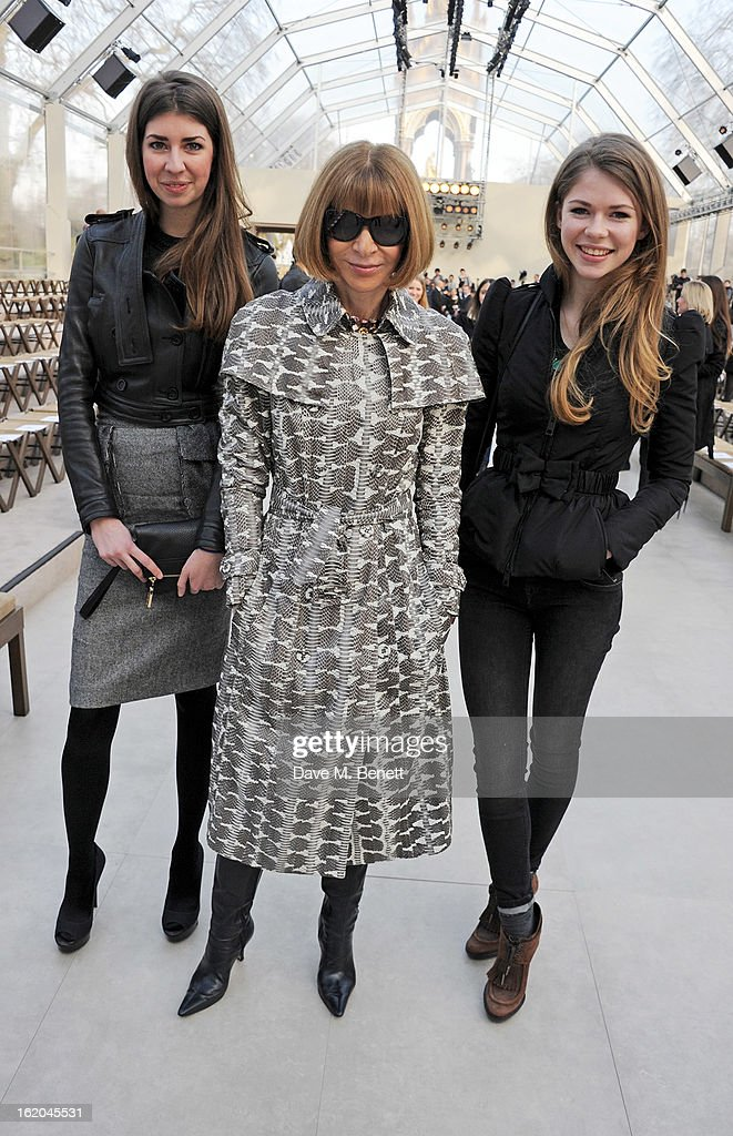 Anna Wintour (C) and Ellie Wintour sit in the front row for the Burberry Prorsum Autumn Winter 2013 Womenswear Show at Kensington Gardens on February 18, 2013 in London, England.