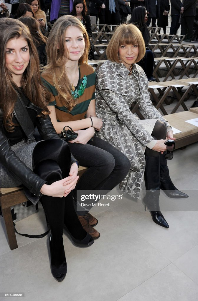 Anna Wintour (R) and Ellie Wintour (C) sit in the front row for the Burberry Prorsum Autumn Winter 2013 Womenswear Show at Kensington Gardens on February 18, 2013 in London, England.