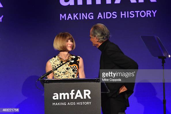 Anna Wintour and Patrick Demarchelier speak onstage at the 2015 amfAR New York Gala at Cipriani Wall Street on February 11 2015 in New York City