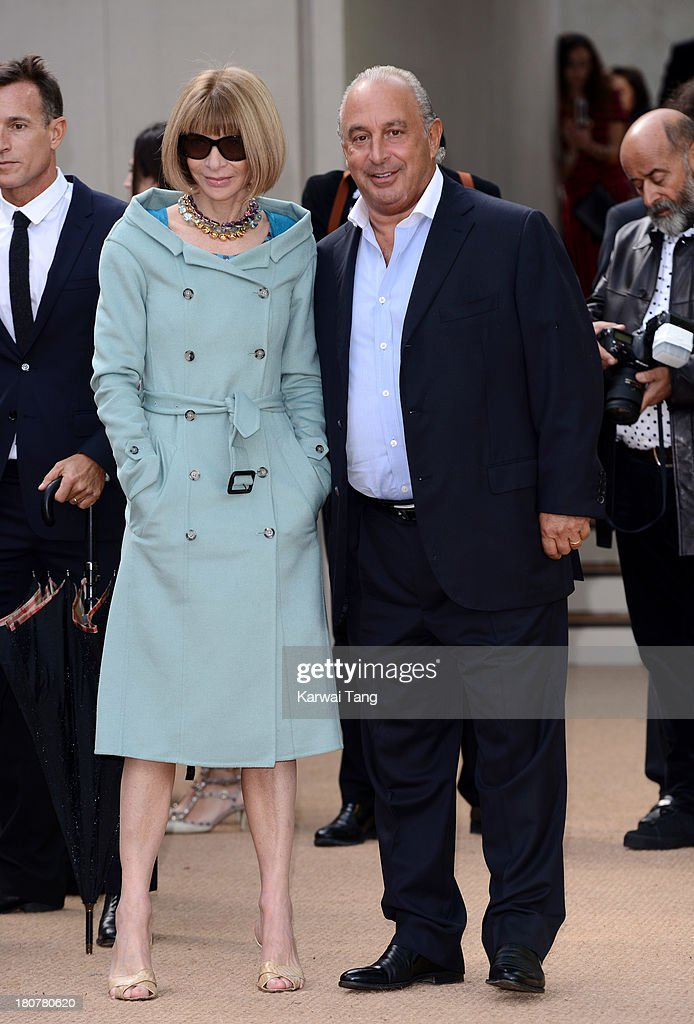 Anna Wintour and Sir Phillip Green attend the Burberry Prorsum show during London Fashion Week SS14 at Kensington Gardens on September 16, 2013 in London, England.