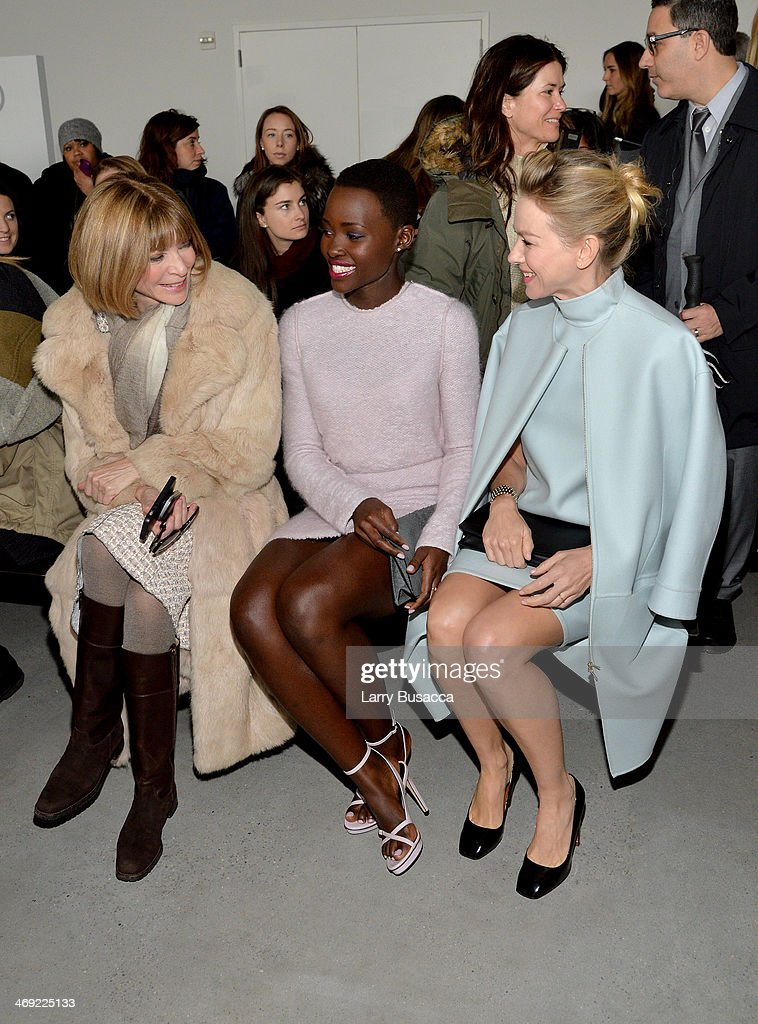 <a gi-track='captionPersonalityLinkClicked' href=/galleries/search?phrase=Anna+Wintour&family=editorial&specificpeople=202210 ng-click='$event.stopPropagation()'>Anna Wintour</a>, <a gi-track='captionPersonalityLinkClicked' href=/galleries/search?phrase=Lupita+Nyong%27o&family=editorial&specificpeople=10961876 ng-click='$event.stopPropagation()'>Lupita Nyong'o</a>, and <a gi-track='captionPersonalityLinkClicked' href=/galleries/search?phrase=Naomi+Watts&family=editorial&specificpeople=171723 ng-click='$event.stopPropagation()'>Naomi Watts</a> attend the Calvin Klein Collection fashion show during Mercedes-Benz Fashion Week Fall 2014 at Spring Studios on February 13, 2014 in New York City.