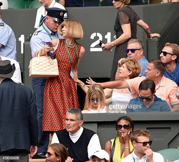 Anna Wintour nearly gets knocked to the ground by security at the Sam Querry v Roger Federer match on day four of the Wimbledon Tennis Championships...