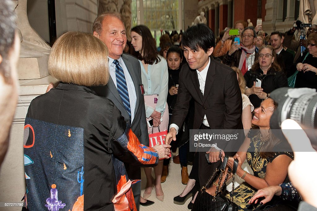 Anna Wintour (back to camera) shakes hands with OMA New York director Shohei Shigematsu during the 'Manus x Machina: Fashion in an Age of Technology' press preview at the Metropolitan Museum of Art on May 2, 2016 in New York City.