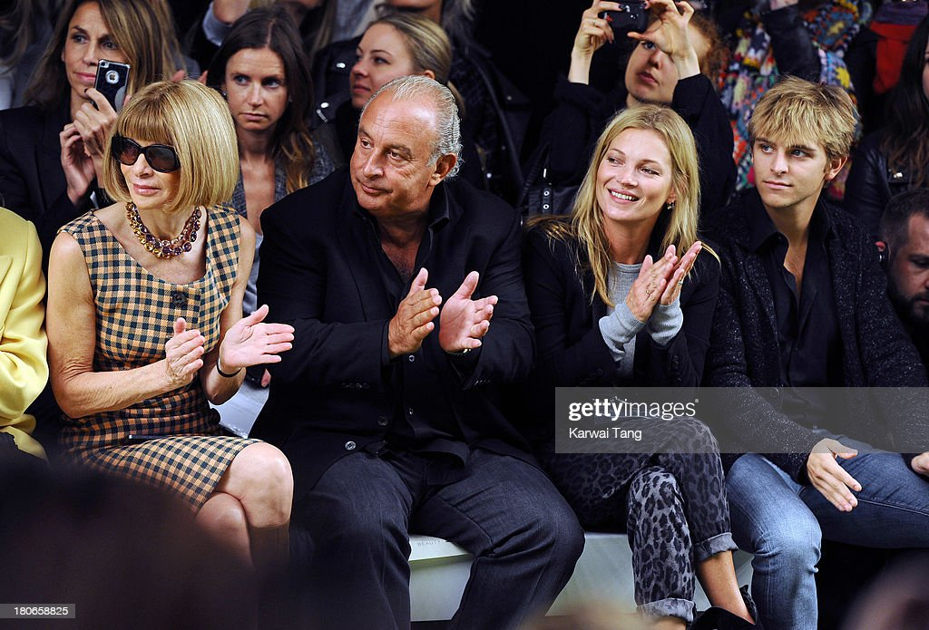 <a gi-track='captionPersonalityLinkClicked' href=/galleries/search?phrase=Anna+Wintour&family=editorial&specificpeople=202210 ng-click='$event.stopPropagation()'>Anna Wintour</a>, Sir Phillip Green, <a gi-track='captionPersonalityLinkClicked' href=/galleries/search?phrase=Kate+Moss&family=editorial&specificpeople=201830 ng-click='$event.stopPropagation()'>Kate Moss</a> and <a gi-track='captionPersonalityLinkClicked' href=/galleries/search?phrase=Brandon+Green+-+Socialite&family=editorial&specificpeople=15252528 ng-click='$event.stopPropagation()'>Brandon Green</a> attend the Unique show during London Fashion Week SS14 at TopShop Show Space on September 15, 2013 in London, England.