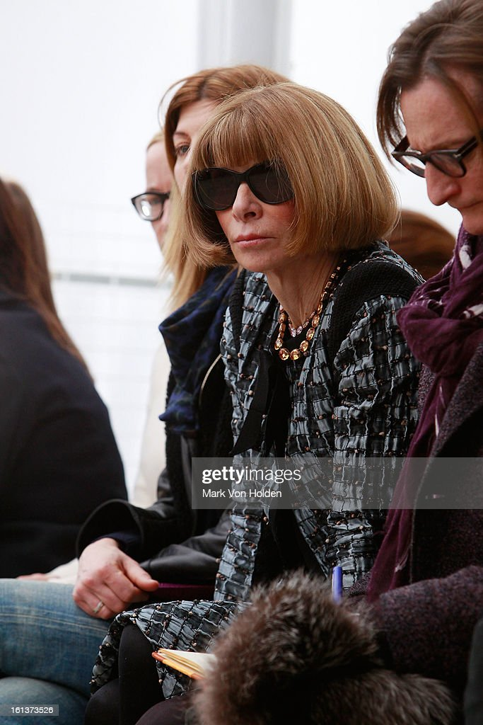 Anna Wintour watches the runway at the Derek Lam fall 2013 fashion show during Mercedes-Benz Fashion Week at Sean Kelly Gallery on February 10, 2013 in New York City.