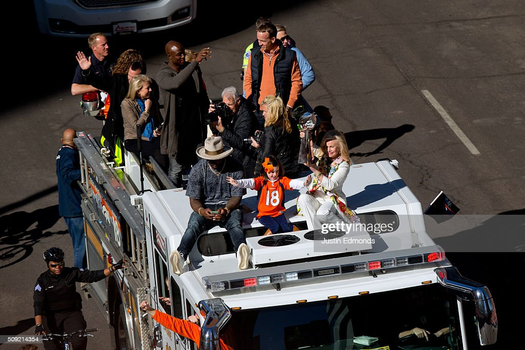Annabel Bowlen holds the Lombardi Trophy while riding with Super Bowl MVP Von Miller of the Denver Broncos along with Demarcus Ware #18 Peyton...
