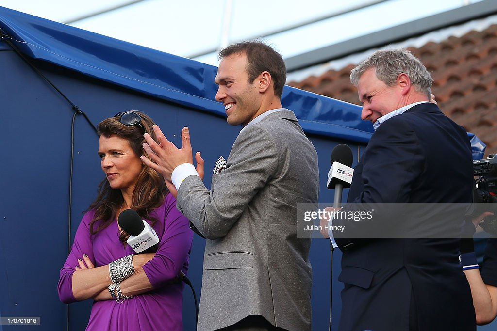 Annabel Croft, Ross Hutchins and Rob Curling cheer play on court during the Rally Against Cancer charity match on day seven of the AEGON Championships at Queens Club on June 16, 2013 in London, England.