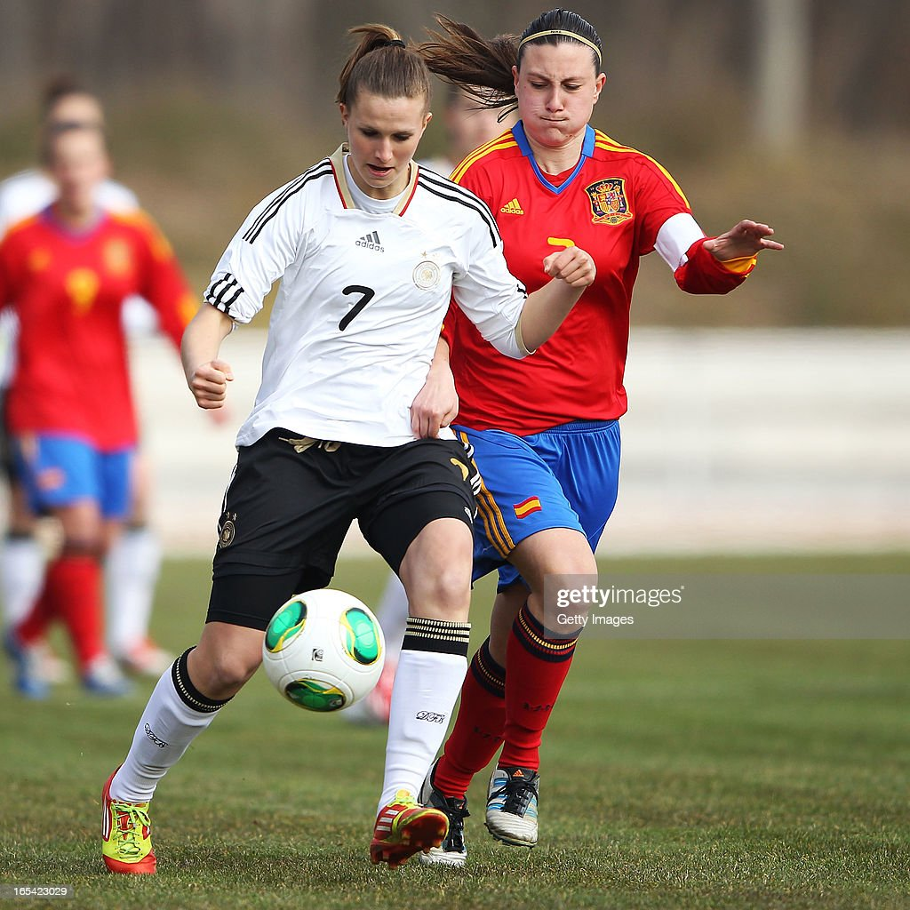 Annabel Jaeger of Germany is challenged by Gema Gili Giner of Spain during the Women's UEFA U19 Euro Qualification match between U19 Germany and U19 Spain at Waldstadion in Viernheim on April 4, 2013 in Viernheim, Germany.