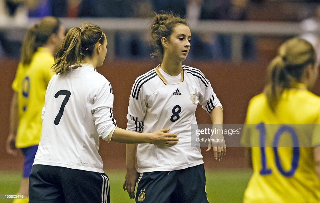 Annabel Jager of Germany congratulates team mate Sara Dabritz after she their team's 2nd goal during the Under 19 Women's international friendly between Sweden and Germany, at Tipshallen Stadium on November 21, 2012 in Vaxjo, Sweden.