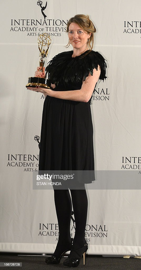 Annabel Jones, executive producer, holds her trophy at the 40th International Emmy Awards November 19, 2012 in New York. Jones won the TV movie/mini series category for 'Black Mirror.' AFP PHOTO/Stan HONDA