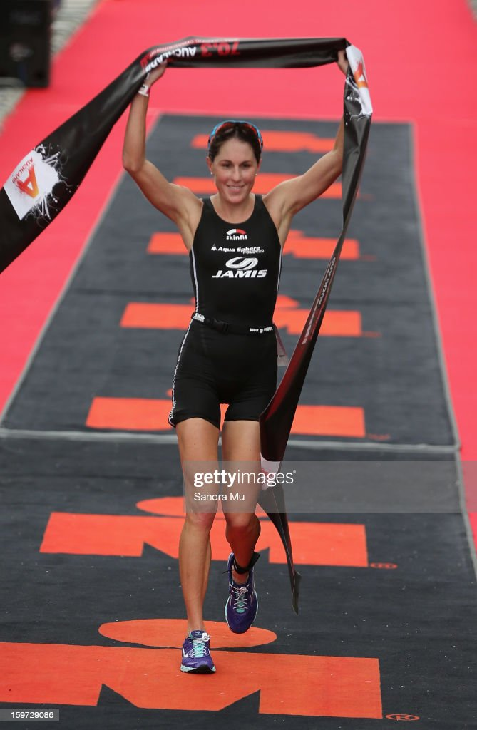 Annabel Luxford of Australia celebrates winning during the Ironman 70.3 Auckland triathlon on January 20, 2013 in Auckland, New Zealand.
