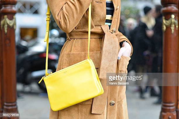 Annabel Pesant poses wearing H and M coat and Celine bag on Day 3 of Paris Fashion Week Womenswear FW15 on March 5 2015 in Paris France