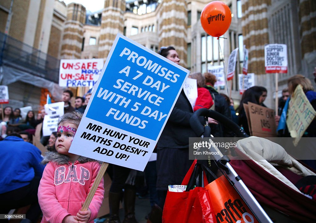 A young girl holds a placard as Junior Doctors protest outside the Department of Health at the Government's intention to impose new contracts on February 11, 2016 in London, England. After negotiations between the Government and the British Medical Association lasting four years failed to reach an agreement, Jeremy Hunt has announced in the House of Commons that new contracts would be imposed on Junior Doctors from August 1st 2016.