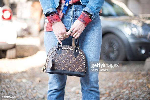 Annabel Rosendahl poses wearing a Gucci denim jacket Coach shirt and Louis Vuitton bag after the Marni show during Milan Fashion Week Spring/Summer...