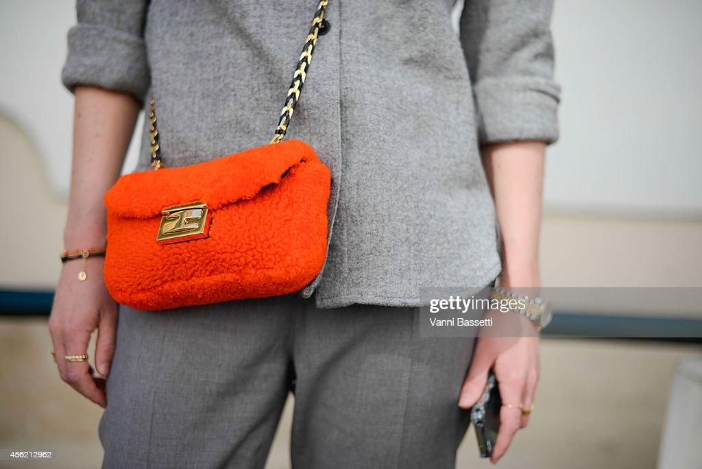 Annabel Rosendahl poses wearing an Isabel Marant jacket FWSS pants and Fendi bag on September 27 2014 in Paris France