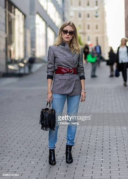 Annabel Rosendahl wearing a black bucket bag and a plaid blazer with belt and denim jeans outside Ida Klamborn during the second day of the Stockholm...