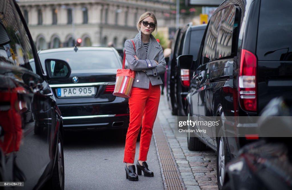Annabel Rosendahl wearing red bag, checked grey blazer jacket outside House of Dagmar on August 31, 2017 in Stockholm, Sweden.