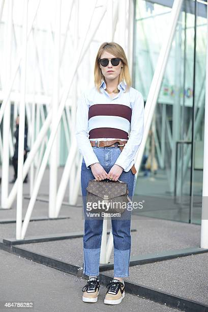 Annabel Rosendhal poses wearing Stella McCartney top and pants Nike shoes and Louis Vuitton bag on February 28 2015 in Milan Italy