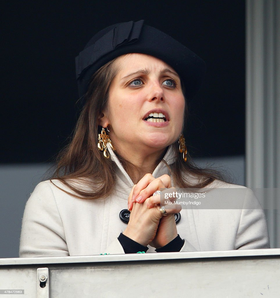 Annabel Waley-Cohen cheers husband Sam Waley-Cohen as he rides Rajdhani Express in the Ryanair Chase on Day 3 of the Cheltenham Festival at Cheltenham Racecourse on March 13, 2014 in Cheltenham, England.