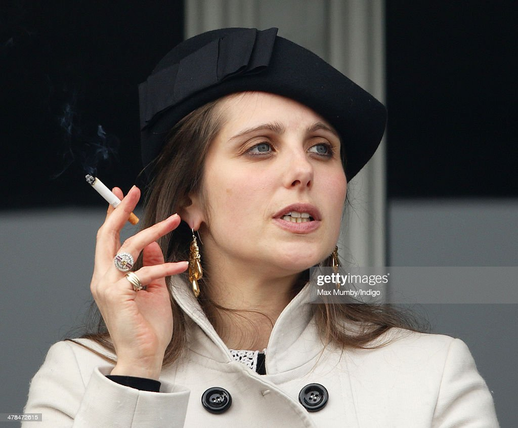Annabel Waley-Cohen watches husband Sam Waley-Cohen as he rides Rajdhani Express in the Ryanair Chase on Day 3 of the Cheltenham Festival at Cheltenham Racecourse on March 13, 2014 in Cheltenham, England.