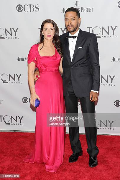 Annabella Sciorra and Maxwell attend the 65th Annual Tony Awards at the Beacon Theatre on June 12 2011 in New York City