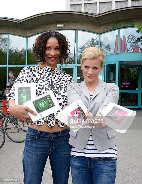 Annabelle Mandeng and Eva Habermann pose with books as they give away books during World Book Day on April 23 2014 in Berlin Germany