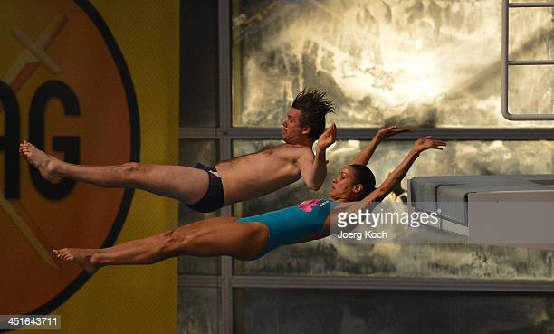 Annabelle Mandeng and Steffen Groth jump during the TV show 'TV Total Turmspringen' on November 23 2013 in Munich Germany 'TV Total Turmspringen' is...
