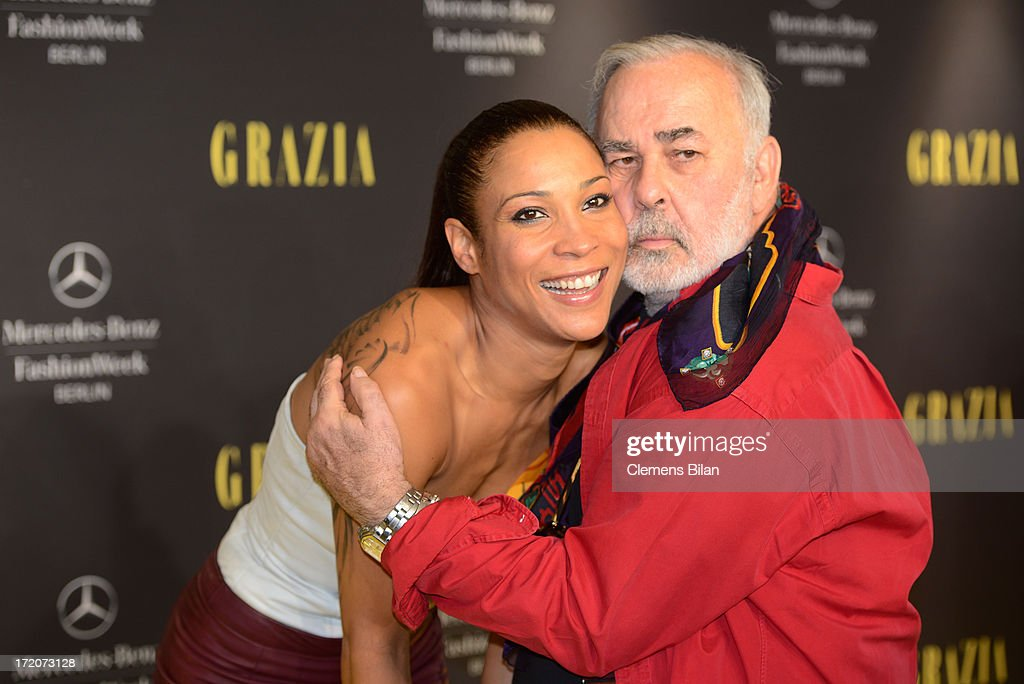 Annabelle Mandeng and Udo Walz attend the Mercedes-Benz Fashion Week Berlin Spring/Summer 2014 Preview Show by Grazia at the Brandenburg Gate on July 1, 2013 in Berlin, Germany.