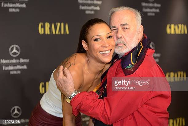 Annabelle Mandeng and Udo Walz attend the MercedesBenz Fashion Week Berlin Spring/Summer 2014 Preview Show by Grazia at the Brandenburg Gate on July...
