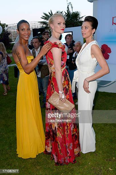 Annabelle Mandeng Franziska Knuppe and Lilly Becker attend the Raffaello Summer Day 2013 at Kronprinzenpalais on June 21 2013 in Berlin Germany