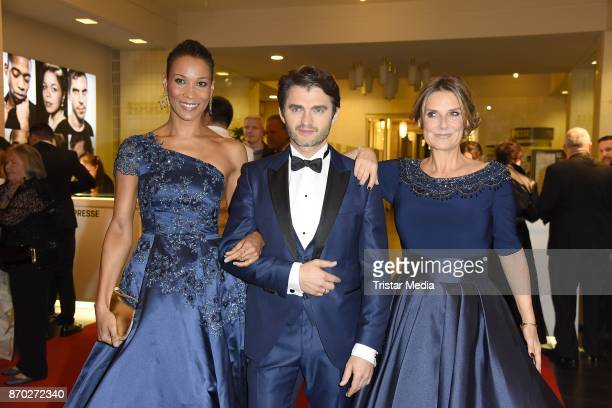 Annabelle Mandeng in a dress of Guido Maria Kretschmer Lenn Kudrjawizki and Kim Fisher in a dress of Uwe Herrmann attend the Leipzig Opera Ball on...