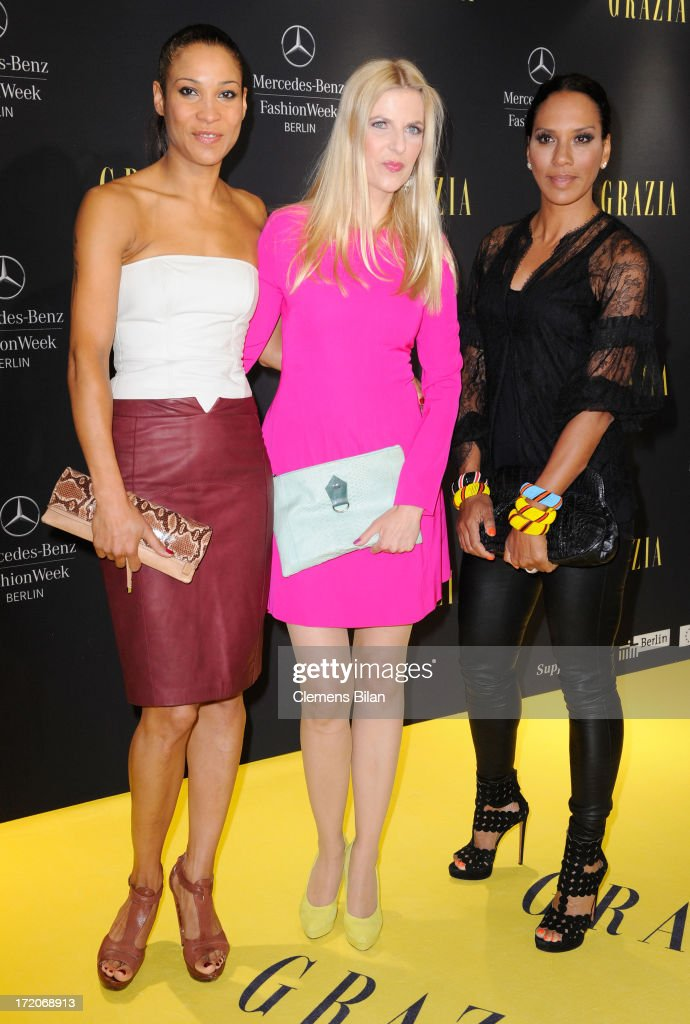 Annabelle Mandeng, Tanja Buelter and Barbara Becker attend the Mercedes-Benz Fashion Week Berlin Spring/Summer 2014 Preview Show by Grazia at the Brandenburg Gate on July 1, 2013 in Berlin, Germany.