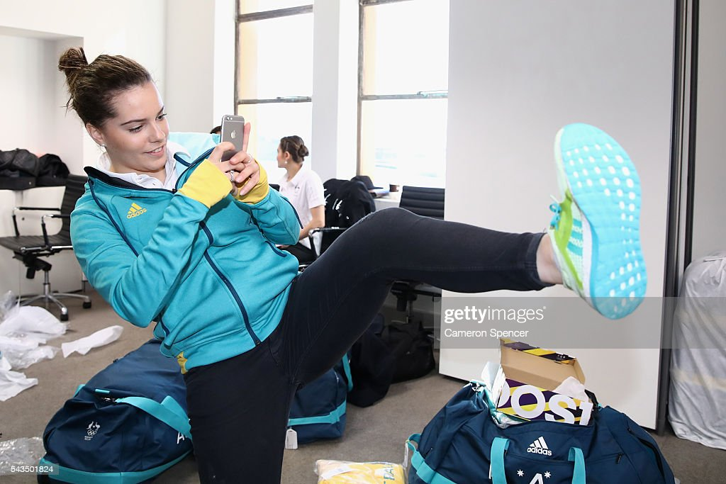 Annabelle Smith photographs her new shoes during the Australian Olympic Games diving team announcement at the Museum of Contemporary Art on June 29, 2016 in Sydney, Australia.