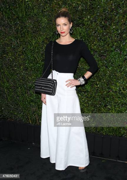 Annabelle Wallis attends the Chanel Charles Finch PreOscar Dinner held at Madeo Restaurant on March 1 2014 in Los Angeles California
